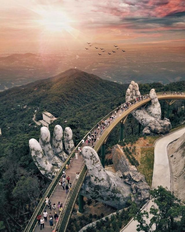 Sunset from the one of a kind hand-shaped bridge in Vietnam